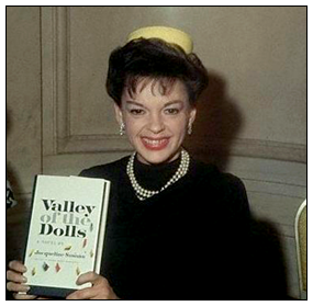 Judy Garland holds Valley of the Dolls book